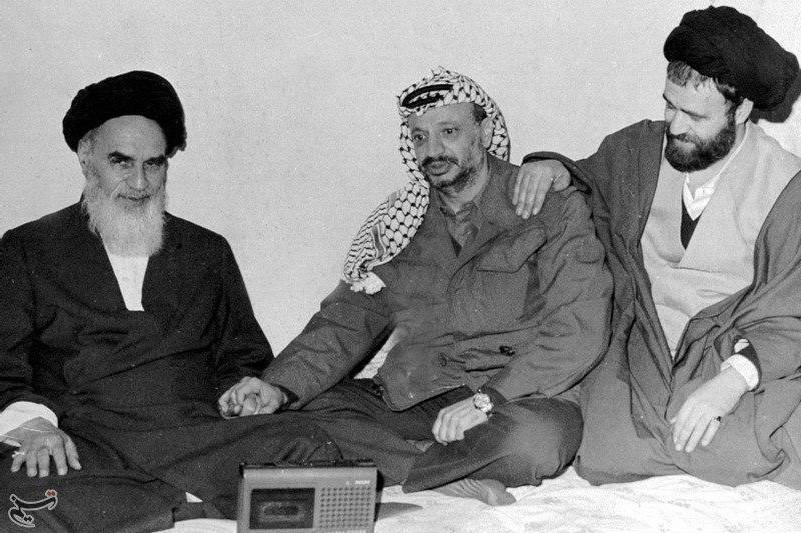 Khomeini and Yasser Arafat amicably holding hand
